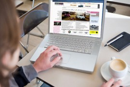 Young Man Using Laptop in Cafe --- Image by © Stefanie Grewel/zefa/Corbis